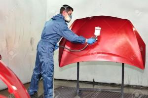 26174856-Professional-car-painter-painting-red-bonnet--Stock-Photo-car-paint